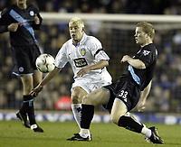 Photo. Aidan Ellis, Digitalsport.<br /> Leeds United v Leicester City.<br /> FA Barclaycard Premiership.<br /> 05/04/2004.<br /> Leeds Alan Smith and Leicester's Ben Thatcher