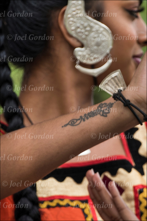 Sri Lankan Kandysan dancer with ethnic tattoo on her arm.<br /> <br /> Body art or tattoos has entered the mainstream it is no longer considered a weird kind of subculture.<br /> <br /> &quot;According to a 2006 Pew survey, 40% of Americans between the ages of 26 and 40 have been tattooed&quot;.<br /> <br /> Kandysan Sri Lankan Ethnic Pride.  The Sri Lankan Dance Academy of NY is a dance school and performing ensemble, promoting cultural harmony between communities of Sri Lankan heritage.
