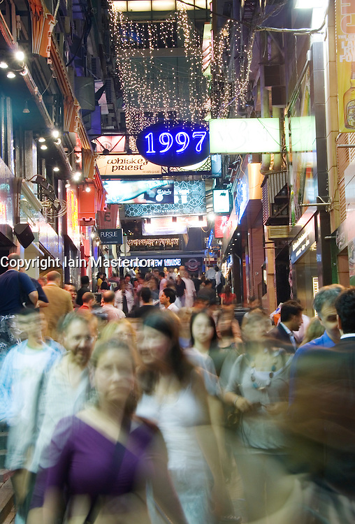 Crowded streets at night in Lan Kwai Fong nightlife district of Hong Kong