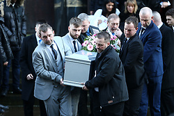 © Licensed to London News Pictures. 31/01/2018. Huddersfield UK. The coffin of 15-year-old Katelyn Dawson is carried out of Huddersfield Parish church after her funeral that is taking place today. Katelyn suffered fatal injuries when a BMW car smashed into a bus stop where she was waiting to go to school on Wakefield Road, Moldgreen, on Wednesday, January 10 2018. Photo credit: Andrew McCaren/LNP