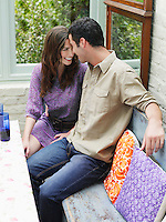 Young couple sitting at verandah table elevated view