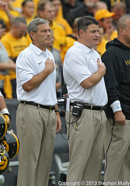 October 6 2013: Iowa Hawkeyes head coach Kirk Ferentz and his son, Offensive Line coach Brian Ferentz, during the National Anthem before the start of the NCAA football game between the Michigan State Spartans and the Iowa Hawkeyes at Kinnick Stadium in Iowa City, Iowa on October 6, 2013. Michigan State defeated Iowa 26-14.