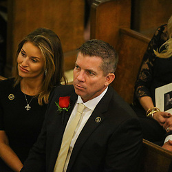 New Orleans Saints head coach Sean Payton with his girlfriend Skylene Montgomery at the funeral service for NFL New Orleans Saints owner and NBA New Orleans Pelicans owner Tom Benson in New Orleans, Friday, March 23, 2018. Benson died last Thursday at the age of 90. (AP Photo/Derick Hingle)