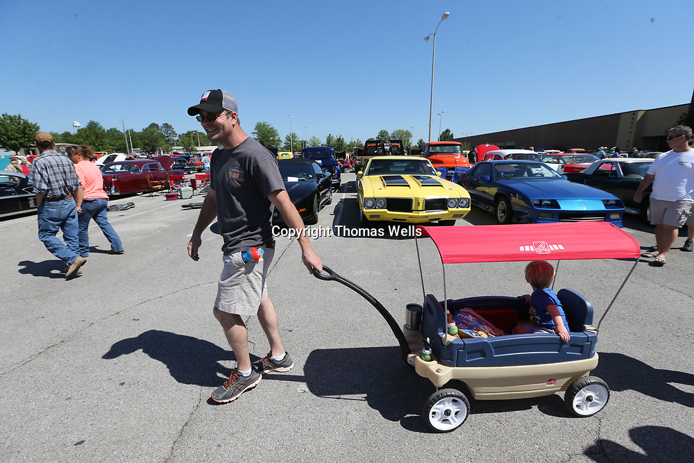 Danny Furniss of Hernando pulls his son, Langston, 2, around in a wagon as they look at all the cars that were at this year's Blue Suede Cruise at the BancorpSouth Arena.