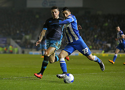 Anthony Knockaert of Brighton and Hove Albion and Sam Hutchinson of Sheffield Wednesday challenge for the ball - Mandatory byline: Paul Terry/JMP - 08/03/2016 - FOOTBALL - Falmer Stadium - Brighton, England - Brighton v Sheffield Wednesday - Sky Bet Championship