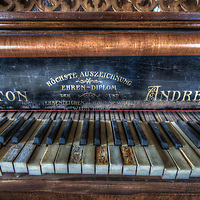 An abandoned palace in East Germany with an ornate piano