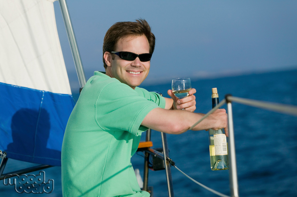 Man on Sailboat with Wine