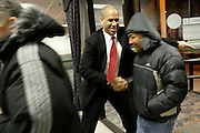Cory Booker holds the door for residents of a public housing building during his second campaign for Newark Mayor in 2006.