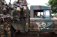 SPLA soldiers near Dalami show off weapons including a battle wagon they captured in a recent battle with SAF troops. The SPLA say they have surrounded Dalami and cut off all suplly lines except by helicopter. All civilians have fled the city.