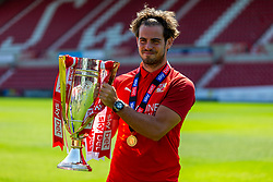 (Free to use courtesy of Sky Bet) Dion Conroy holds the trophy as Swindon Town gather at The County Ground to celebrate becoming Sky Bet League Two Champions, with a socially distanced trophy lift, after the curtailment of the regular season due to the Covid-19 pandemic - Rogan/JMP - 26/06/2020 - The County Ground - Swindon, England - Sky Bet League 2.