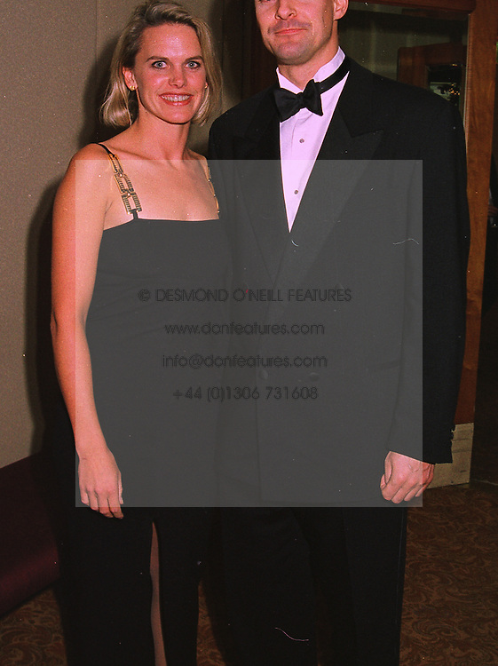 TV presenter ANNA WALKER and MR WILL HARRINGTON, at a ball in London on 17th December 1997.MEG 16