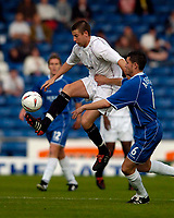Fotball<br /> Foto: SBI/Digitalsport<br /> NORWAY ONLY<br /> <br /> Oldham Athletic v Bolton Wanderers<br /> Pre-season Friendly, 26/07/2004<br /> <br /> Bolton's new signing Michael Bridges (L) controls the ball under pressure from Oldham's Mark Arber.