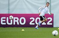 FUSSBALL INTERNATIONAL  EURO 2012   07.06.2012  Training der Deutschen Nationalmannschaft in Danzig Philipp Lahm (Deutschland)    vor einer Werbebande UEFA EURO 2012