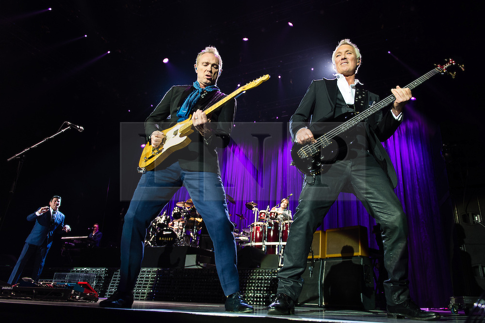 © Licensed to London News Pictures. 17/03/2015. London, UK.   Spandau Ballet performing live at The O2 Arena.   In this picture - Gary Kemp (left), Martin Kemp (right). Spandau Ballet are a British new wave band formed in London in the late 1970s, composed of members Tony Hadley (lead vocals, synthesisers), Gary Kemp ( guitar, keyboards, backing vocals), Steve Norman (saxophone, guitar, percussion), John Keeble –(drums, backing vocals), <br /> Martin Kemp (bass).  Photo credit : Richard Isaac/LNP
