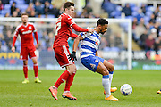 Reading FC striker Gareth McCleary shields the ball from Cardiff City striker Tom Lawrence during the Sky Bet Championship match between Reading and Cardiff City at the Madejski Stadium, Reading, England on 19 March 2016. Photo by Mark Davies.
