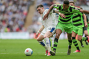 Jack Dunn (Tranmere Rovers) holds off Dan Wishart (Forest Green Rovers) during the Vanarama National League Play Off Final match between Tranmere Rovers and Forest Green Rovers at Wembley Stadium, London, England on 14 May 2017. Photo by Mark P Doherty.