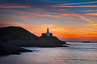 Mumbles Head lighthouse at sunrise from Bracelet Bay<br /> Swansea County<br /> Gower Peninsula<br /> South<br /> Coastal scenery