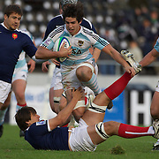 Tomas De La Vega, Argentina, is tackled by Georges Souvent, France,  during the Argentina V France group stage match at Estadio El Coloso del Parque, Rosario, Argentina, during the IRB Junior World Championships. 9th June 2010. Photo Tim Clayton...