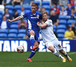 Cardiff City's Eoin Doyle is challenged by Bolton Wanderers' Tim Ream - Photo mandatory by-line: Paul Knight/JMP - Mobile: 07966 386802 - 06/04/2015 - SPORT - Football - Cardiff - Cardiff City Stadium - Cardiff City v Bolton Wanderers - Sky Bet Championship