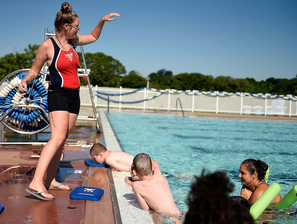 7/26/16 :: REGION :: STAND ALONE :: Fiona Hook, swim instructor with the New London Recreation Department's summer swim program, gives instruction from the poolside as her assistants work with children in the beginning level class in the pool at Ocean Beach Park Tuesday, July 26, 2016.. (Sean D. Elliot/The Day)