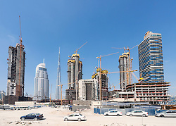 Construction sites of new high-rise luxury apartment towers in Dubai United Arab Emirates