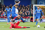 Mathieu Baudry defender for Leyton Orient (6) tackles Lyle Taylor forward for AFC Wimbledon (33) during the Sky Bet League 2 match between AFC Wimbledon and Leyton Orient at the Cherry Red Records Stadium, Kingston, England on 23 April 2016. Photo by Stuart Butcher.