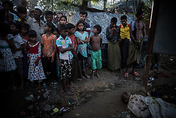 In a refugee camp near Ukhia, Bangladesh. People are gathering around dead body. It is believed the man died of exhaustion, other refugees put him there during nighttime.<br />