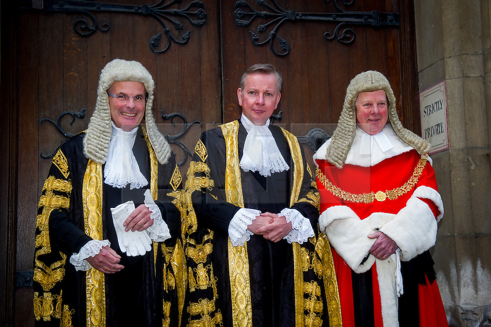 © Licensed to London News Pictures. *19/05/2015. Judges Entrance East, Royal Courts of Justice, London, UK. Lord Chancellor The Rt Hon Michael Gove MP arrives at the Royal Courts of Justice to be sworn in, greeted by Lord Dyson (left) and the Lord Chief Justice, The Lord Thomas of Cwmgeidd (right). Photo credit : David Tett/LNP