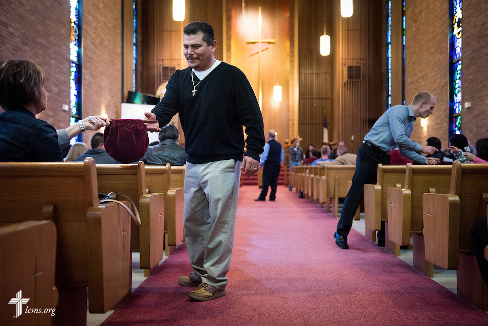 Alejandro Gonzalez (left) collects the offering during a monthly bilingual worship on Sunday, Nov. 22, 2015, at Salem Lutheran Church in Springdale, Ark. LCMS Communications/Erik M. Lunsford