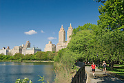 "People jog in Central Park on the jogging track around the Jacqueline Kennedy Onassis Reservoir, ""The Reservoir,"" New York City."