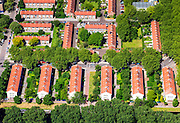 Nederland, Noord-Holland, Amsterdam, 14-06-2012; Slotervaart tussen met Burgemeester Roellstraat en Burgemeester Van Tienhovengracht . Flats gebouwd volgens ruim opgezet stratenplan..De wijk is onderdeel van de Westelijke Tuinsteden, gerealiseerd op basis van het Algemeen Uitbreidingsplan voor Amsterdam (AUP, 1935). Voorbeeld van het Nieuwe Bouwen, open bebouwing in stroken, langwerpige bouwblokken afgewisseld met groenstroken. ..The residential district Slotervaart, one of the western garden cities of Amsterdam-west..  Constructed on the basis of the General Extension Plan for Amsterdam (AUP, 1935). Example of the New Building (het Nieuwe Bouwen), detached in strips, oblong housing blocks alternated with green areas, built in fifties and sixties of the 20th century.. .luchtfoto (toeslag), aerial photo (additional fee required).foto/photo Siebe Swart