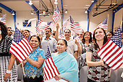 "July 2 - PHOENIX, AZ: RAMILABEN GORDHUNBHUI PATEL, originally from India, and others are sworn in as new US citizens Friday. Nearly 200 people were sworn in as US citizens during the ""Fiesta of Independence"" at South Mountain Community College in Phoenix, AZ, Friday. The ceremony is an annual event on th 4th of July weekend and usually the largest naturalization ceremony of the year in the Phoenix area.  Photo by Jack Kurtz"