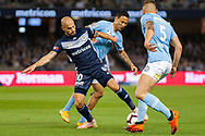 Melbourne Victory midfielder James Troisi (10) fights for the ball against City players at the Hyundai A-League Round 1 soccer match between Melbourne Victory and Melbourne City FC at Marvel Stadium in Melbourne.
