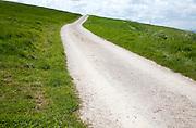 White pathway road on chalk downland Allington Down, Wiltshire, England