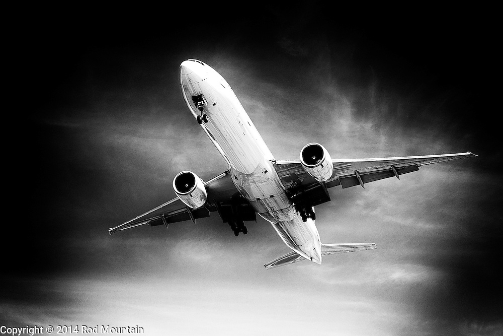 A cargo jet lowers the landing gear on approach to YVR.<br /> <br /> Photo: &copy; Rod Mountain<br /> <br /> http://www.rodmountain.com