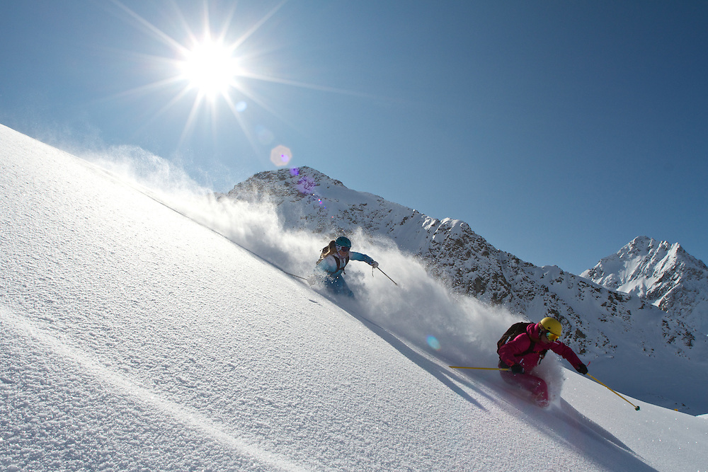 2 women skiing the powder, Kuhtai, Tirol, Austria
