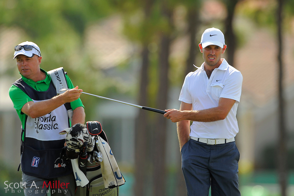 Charl Schwartzel and his caddie during the third round of the Honda Classic at PGA National on March 3, 2012 in Palm Beach Gardens, Fla. ..©2012 Scott A. Miller.