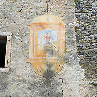 LONGARONE, ITALY - SEPTEMBER 28:  A sacred image is seen on one of the many abandoned house in the village of Erto on September 28, 2013 in Longarone, Italy. The Vajont Dam tragedy happened on the night of the October 9, 1963, when a landslide broke away from Monte Toc and fell into the Vajont River, causing a wave that struck the neighboring towns and killing more than 2000 people.  (Photo by Marco Secchi/Getty Images)