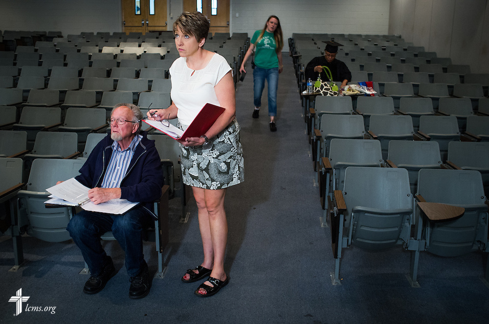 Kim Vieker, script supervisor, and her father and director Dr. Ardon Albrecht work together during filming of 'The First Rosa' documentary on Thursday, September 25, 2014, at Concordia College Alabama in Selma, Ala. LCMS Communications/Erik M. Lunsford