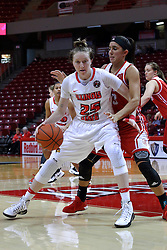 01 January 2017: Hannah Green makes her way to the paint defended by Leti Lerma during an NCAA Missouri Valley Conference Women's Basketball game between Illinois State University Redbirds the Braves of Bradley at Redbird Arena in Normal Illinois.