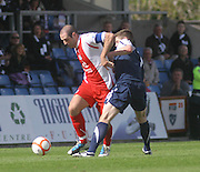 Dundee captain Gary Harkins goes past Ross County's Ian Vigurs - Ross County v Dundee - IRN BRU Scottish Football League First Division at Victoria Park<br /> <br /> <br /> <br /> http://www.davidyoungphoto.co.uk