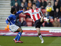 Photo: Jonathan Butler.<br />Southampton v Ipswich Town. Coca Cola Championship. 24/02/2007.<br />Jamie Peters of Ipswich is handed off by Gareth Bale of Southampton.