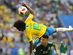 July 2, 2018 - Samara, Russia - July 2, 2018, Russia, Samara, FIFA World Cup 2018, 1/8 finals. Football match of Brazil - Mexico at the stadium Samara - Arena. Player of the national team Willian (19), Irving Lozano  (Credit Image: © Russian Look via ZUMA Wire)