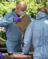 © Licensed to London News Pictures. 12/07/2020. London, UK. Police forensics remove a knife in an evidence box from the scene of a murder on the Black Prince Estate in Kennington South London in which a man, believed to be in his 30s, was stabbed to death late last night . Photo credit: Ben Cawthra/LNP