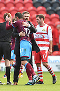 Sunthorpe United manager Graham Alexander and Scunthorpe United forward Lee Novak (17) at end of  the EFL Sky Bet League 1 match between Doncaster Rovers and Scunthorpe United at the Keepmoat Stadium, Doncaster, England on 17 September 2017. Photo by Ian Lyall.