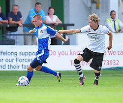 Bristol Rovers' Eliot Richards  has his shirt pulled - Photo mandatory by-line: Dougie Allward/JMP - Tel: Mobile: 07966 386802 16/07/2013 - SPORT - FOOTBALL - Bristol -  Hereford United V Bristol Rovers - Pre Season Friendly