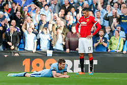 Chris Smalling of Manchester United seems to know a red card is imminent after a foul on James Milner of Manchester City - Photo mandatory by-line: Rogan Thomson/JMP - 07966 386802 - 02/11/2014 - SPORT - FOOTBALL - Manchester, England - Etihad Stadium - Manchester City v Manchester United - Barclays Premier League.