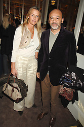 INDIA HICKS and CHRISTIAN LOUBOUTIN at a party to celebrate the publication of Top Tips For Girls by Kate Reardon held at Claridge's, Brook Street, London on 28th January 2008.<br />