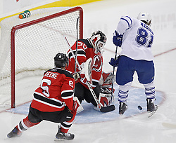 Feb 5, 2010; Newark, NJ, USA; New Jersey Devils goalie Martin Brodeur (30) makes a save on Toronto Maple Leafs right wing Phil Kessel (81) during the third period at the Prudential Center. The Devils rallied with three goals in the period to win 4-3.