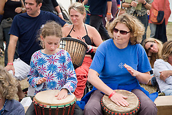 Young women and girl playing tomtoms at the WOMAD (World of Music; Arts and Dance) Festival in reading; 2005,